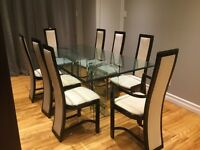 Glass Dining Room Table with 8 Chairs PRICED TO SELL.