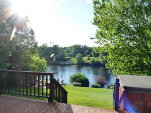 **  WATERFRONT BEAUTY!  4 BEDROOM  SOLID BRICK  FAMILY HOME! **