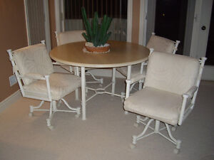 Just Reduced Must sell: Show Room Dinette Suite