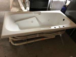 Used white  jetted tub
