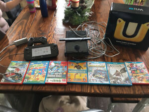 Wii u with 7 games and 2 controllers