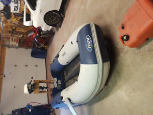 10 foot zodiac zoom (like new). 9.5 johnson outboard