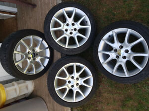 Goodyear Eagle sport tires and Aluminum Dodge Dart Rims.