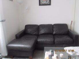 Corner Sofa in Black/Brown in Good Condition buyer must pick up