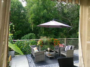 Peaceful  waterside Laval condo , with NO BACKYARD NIEGHBORS
