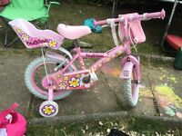 Pink bike with stabilisers
