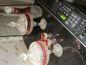 Crystal decanter and two tall mantle jars