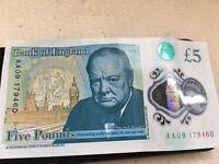 Plastic five pound note
