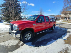 2007 Ford F250 Superduty CrewCab 4x4 with liftgate.