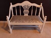 White bench with damask print