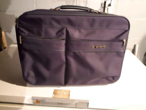 Suitcase luggage 20 inches long by 15 inches high very good cond