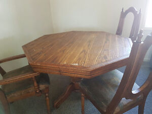 Solid oak table with three chairs and leaf - fixer upper