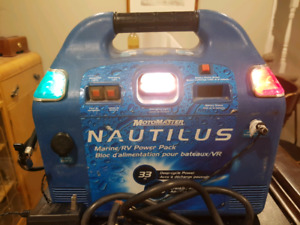 Battery booster pack with air compressor and lights