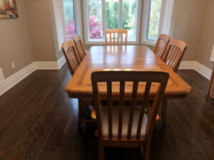 Extendable Dining Table with six chairs and a Hutch