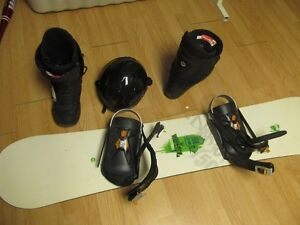 Snowboard with bindings, boots, and helmet