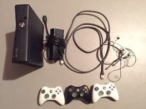 XBOX 360 slim with 18 games