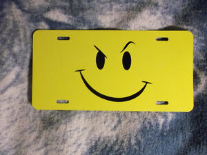 smirk smiley face emoji license plate