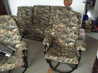 Couch and two rocking chairs that swivel