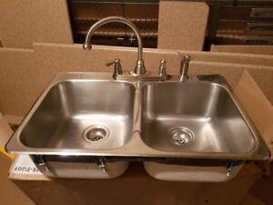 Stainless Steel Sink and Moen Faucet