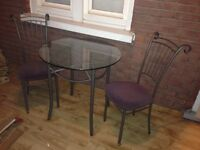 Small glass table and two chairs