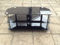 Glass shelved tv stand