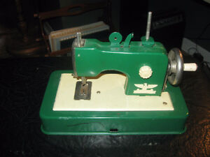 Vintage Casige Toy Sewing Machine  This machine is from the 1940