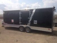 Enclosed trailer 27' heated w/ electricity.