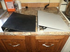 2 Binders for sale