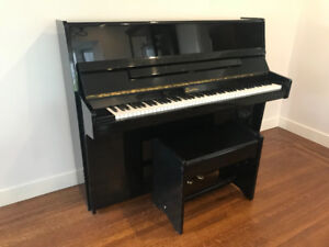 Upright black piano