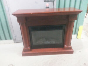 Wooden mantel and electric fireplace $300.00 OBO