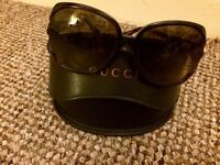 Gucci sunglasses genuine with case. Scratched lens