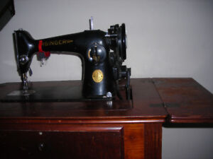 Singer sewing machine in cabinet for sale.