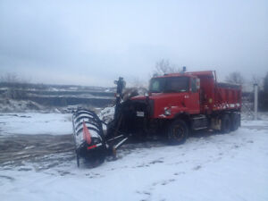 1999 Volvo dump truck with plow and wing