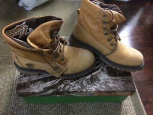 Selling my timberland boots size 6-1/2 Adult female Size