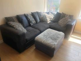 Right hand dark grey & black pillow-back corner sofa & ottoman £225ONO