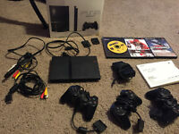 Playstation 2 with 3 controllers and Games