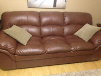 Brown Leather Couch and matching chair. Excellent Condition!!