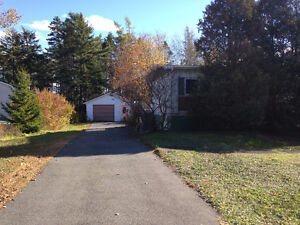 NICE BUNGALOW ON LARGE LOT IN GREAT LOCATION