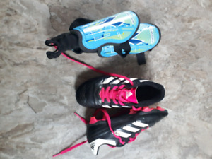 Soccer cleats (size 13)  and shin pads