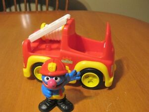 SESAME STREET GROVER FIGURE WITH FIRE TRUCK