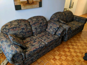 Two matching pattern love seat couches