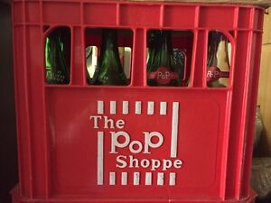 Pop shoppe plastic crate with 12 bottles
