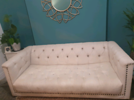 Cream Chesterfield couch