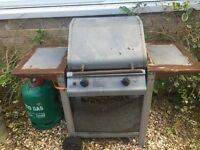 Old BBQ with gas cylinder