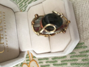 Handcrafted metal ring with natural gemstone.