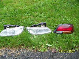 97 Pontiac Grand AM head light lens brake light lens and rad
