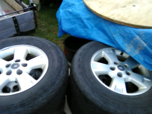 4 factory aluminum wheels with MS tires for a ford escape