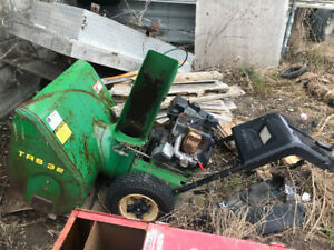 John deer snow blower for parts or fix 300$