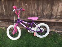 "Magna wild 10"" bike with stabilisers."