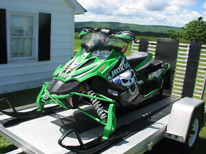 Snowmobile plus Trailer for sale.